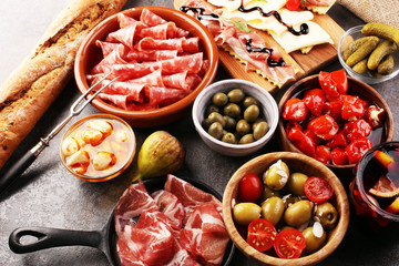 spanish tapas and sangria on wooden table - mediterran antipasti set