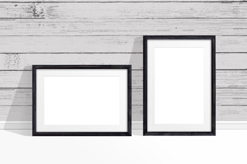 Two photo frames mock up near old painted wooden planks wall