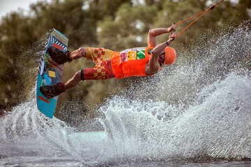 Extreme jumps on the board on the water. A lot of splashes and splashes of water. Wall mural