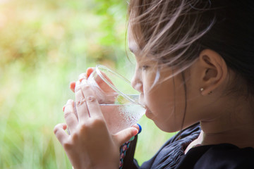 Children are drinking water in the morning.