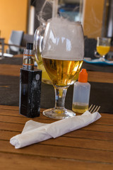 Vaporizer and smoking beer with bottle and fork on table