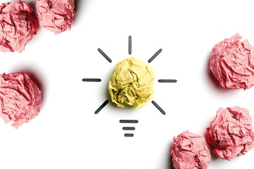 Crumpled yellow paper light bulb. Metaphor for good idea. Inspiration concept