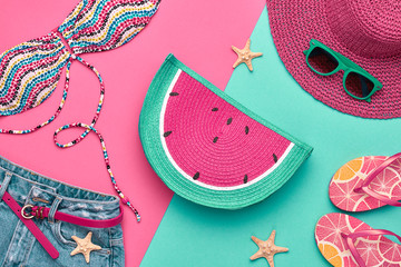 Fashion. Summer clothes, Accessories set. Beach Outfit. Trendy Swimsuit Bikini, Stylish Sunglasses, fashion Denim, summer hat. Creative Art girl. Tropical summer Color. Top View Vacation Concept
