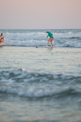 Kids learning to surf at a surf school in Santa Teresa, Costa Rica