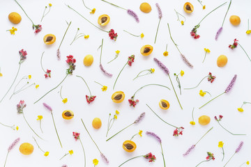 Fototapete - Fruity pattern. Fruits, plants and flowers on a white background. Food background. Top view.