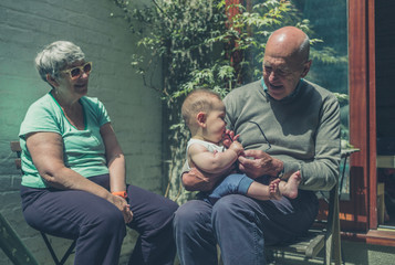 Grandparents in yard with baby