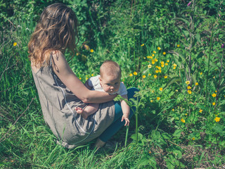 Young mother in nature with baby