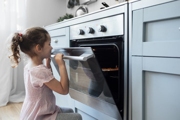 Girl looking into oven