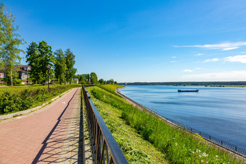 The shore of the grandiose Russian Volga river near the town of Myshkin on a summer day. Yaroslavl region