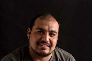 Portrait of a latin man on black background