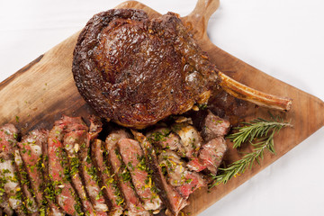 tasty grilled beef on wood plate