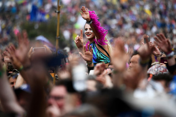 Revellers dance as Barry Gibb performs at Worthy Farm in Somerset during the Glastonbury Festival