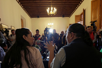 Frida Adame Urtiz, daughter of slain journalist Salvador Adame, listens to journalist Patricia Montreal during a news conference in Morelia