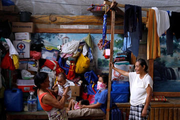 Evacuated residents rest at evacuation centre in Iligan