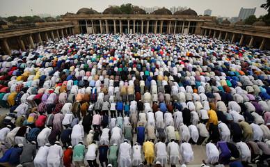 Muslims offer Eid al-Fitr prayers at Sarkhej Roza mosque in Ahmedabad