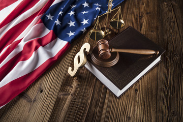 Gavel on the Bible. American flag on wooden table. Independence Day. 4 th of July.