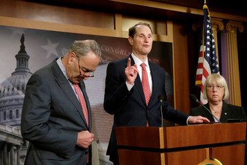 Senate Minority Leader Chuck Schumer (D-NY) with Senators Ron Wyden (D-OR) and Patty Murray (C) hold a news conference