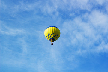 Flight of large air balloon against blue sky