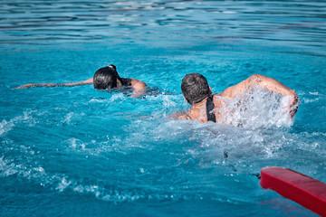 Lifeguard swimming towards the victim