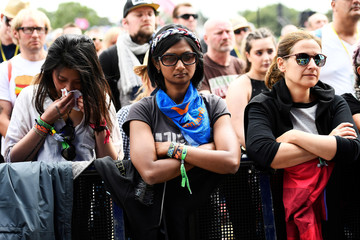 Revellers observe a minute of silence at Worthy Farm in Somerset during the Glastonbury Festival