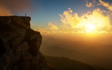 Beautiful mountain landscape with sunset sky in autumn time. Photographer takes pictures on top of the mountain