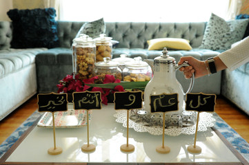 Eid greetings surround sweets and coffee at home of Yemeni-American Muslim family on Eid al-Fitr in New York