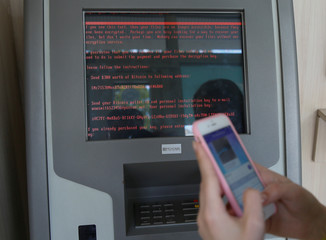 A message demanding money is seen on a monitor of a payment terminal at a branch of Ukraine's state-owned bank Oschadbank after Ukrainian institutions were hit by a wave of cyber attacks earlier in the day, in Kiev