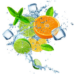 Fresh limes, oranges and lemons with water splash.