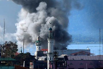 An explosion is seen after a Philippines army aircraft released a bomb during an airstrike in Marawi city