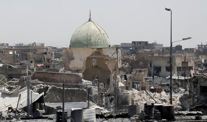 A destroyed mosque is seen among other houses near the Grand Al-Nuri mosque at the frontline in the Old City of West Mosul