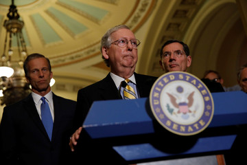 Senate Majority Leader Mitch McConnell, accompanied by Sen. John Barrasso (R-WY) and Sen. John Thune (R-SD), speaks to the media about plans to repeal and replace Obamacare on Capitol Hill in Washington