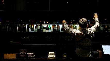 A Monvinic's sommelier takes a bottle of wine in Barcelona