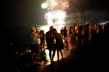 People watch fireworks celebrating the summer solstice in Malaga