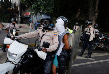 A protester is detained during a rally against Venezuela's President Maduro's government in Caracas