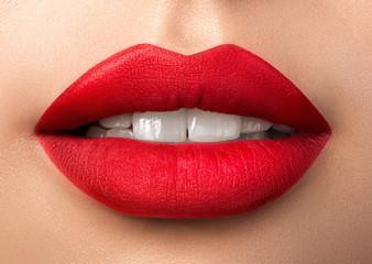 Close up view of beautiful woman lips with red matt lipstick Wall mural