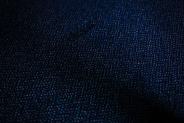 a dark blue texture or background with small loops