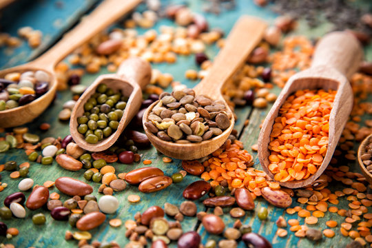 Raw legume on old rustic wooden table.