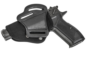 Leather holster with handgun. Isolated