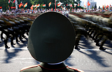 Belarussian guard of honour stands as he takes part in a military parade during celebrations marking Independence Day in Minsk