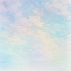 A soft sky on crumpled paper background