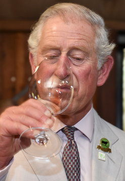 Britain's Prince Charles takes a drink during his visit to the Oranje Tractor Wines in Albany
