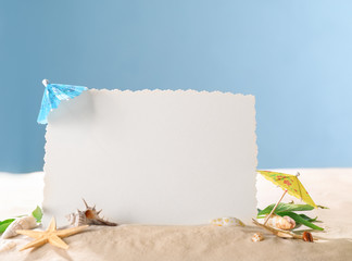 Blank card, starfish and shells on sand against color background. Concept of travel and vacation