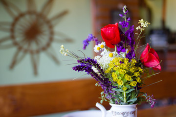 Bouquet of filed flowers in a pot for home deco.