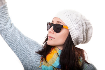 portrait of young urban fashion girl wearing white hat and sunglasses