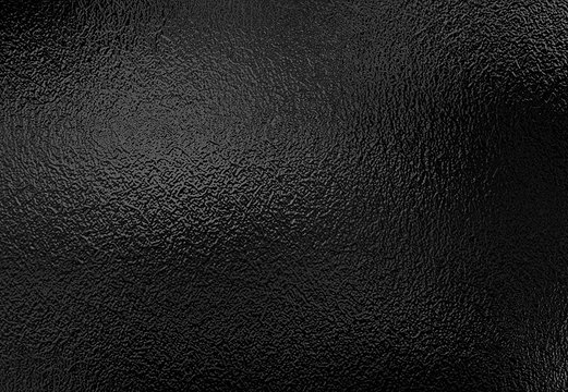 Background texture of shiny black metal foil