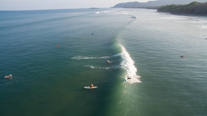 Aerial view of a surfer on a wave in Jaco, Costa Rica