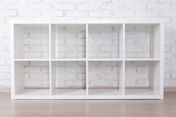 modern wooden shelf over white brick wall