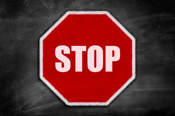 stop sign on a black chalkboard