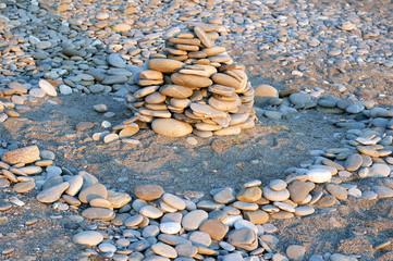 stone pyramid on the sand beach
