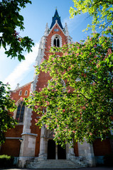 Saint Elisabeth parish church (katholische elisabehkirche) in Vienna, Austria, with spring trees and flowers